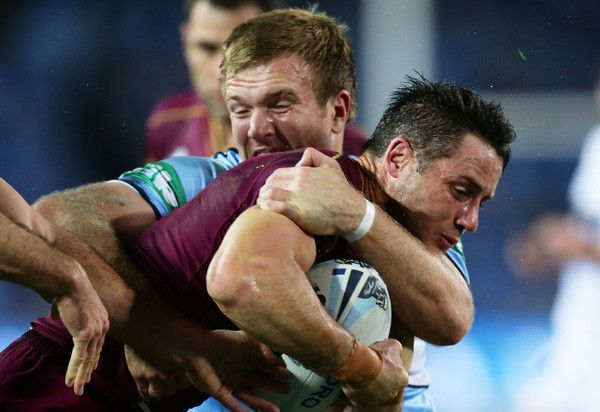Cooper Cronk Photos Photos - Cooper Cronk of the Maroons is tackled during game two of the State Of Origin series between the New South Wales Blues and the Queensland Maroons at ANZ Stadium on June 21, 2017 in Sydney, Australia. - State Of Origin II - NSW v QLD