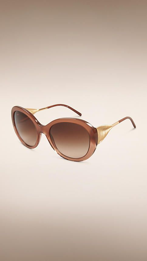 692deb7904ca Burberry Fawn Pink Oversize Round Frame Sunglasses - Oversize round frame  fawn pink acetate sunglasses. Gold metal draped gabardine temples are  inspired by ...