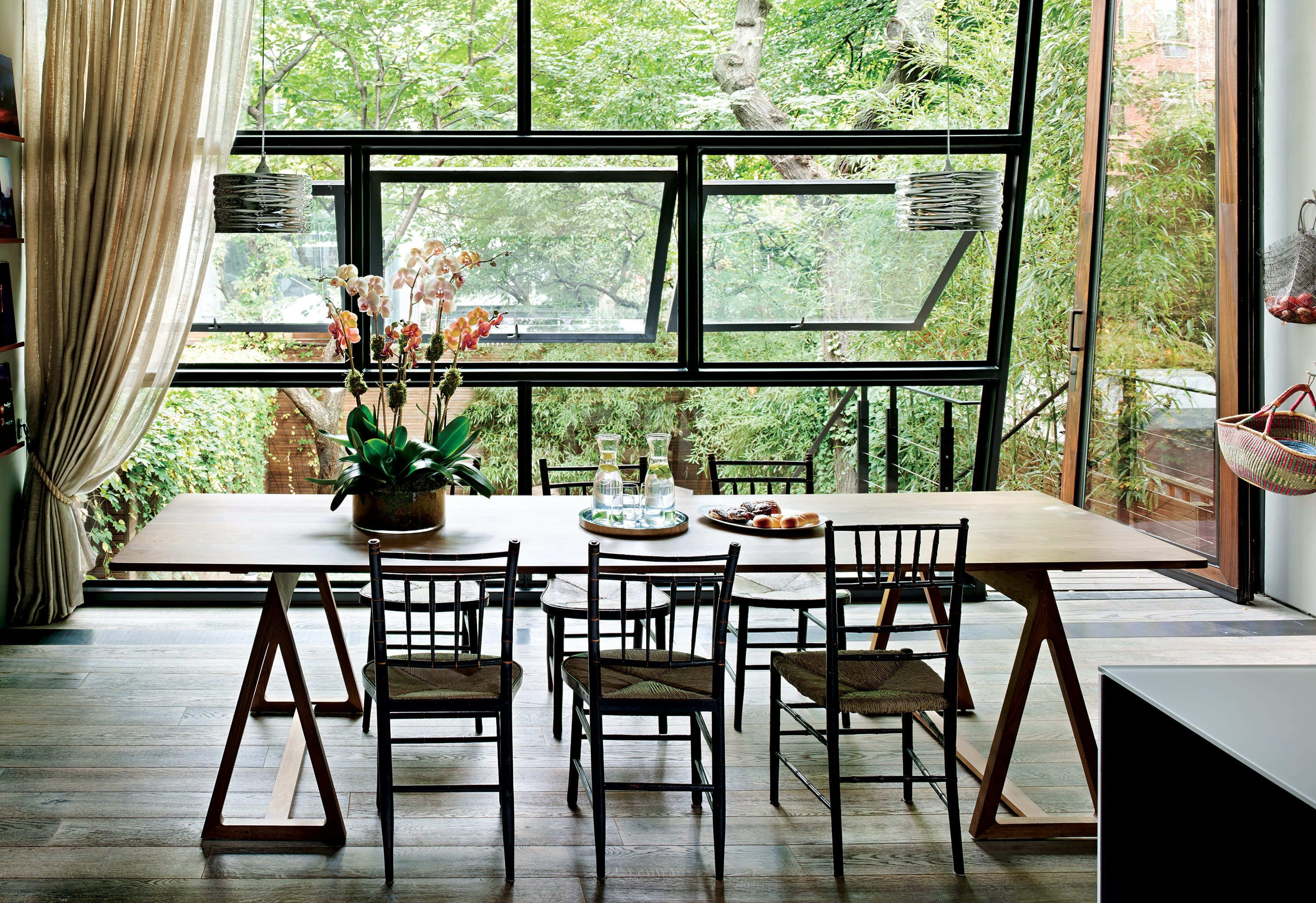 Home interior design windows an oversize trapezoidal door and wall of windows offer a stunning