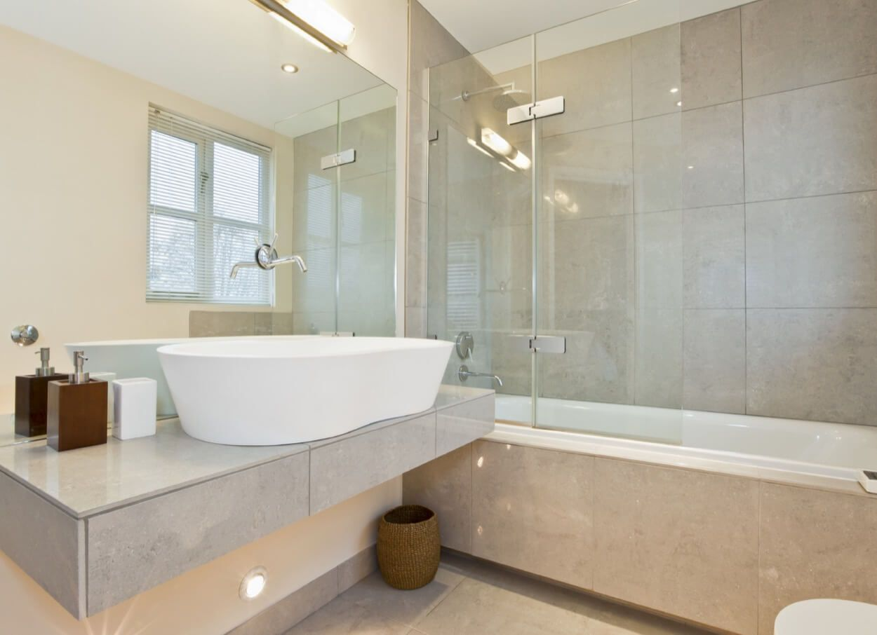 Enclosed bathroom light - Light Toned Bathroom With Glass Enclosed Shower And Bathtub