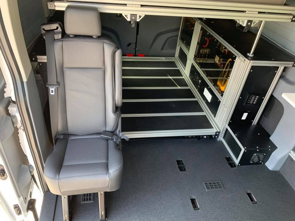Vandoit Utilizes The Ford Factory Seating To Allow For Modularity And Safety This Van Has A Jumpseat Adv Ford Transit Camper Ford Transit Transit Camper