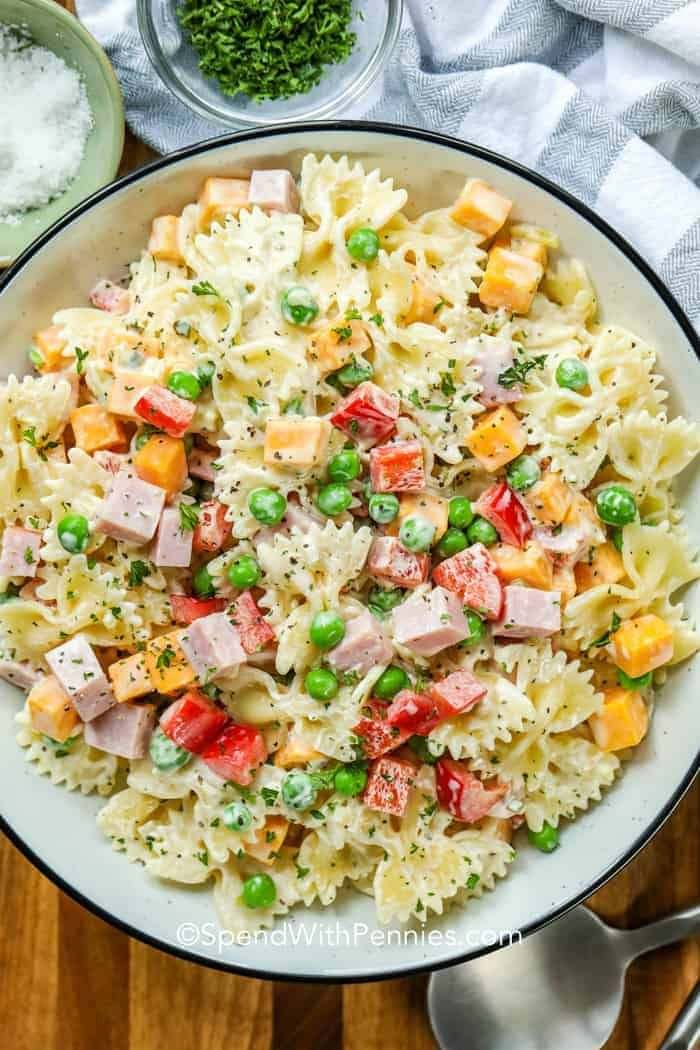 This bow tie pasta salad with a mayo dressing is a hit at every barbecue! It's a creamy combination of bow tie pasta, peas, cheese and ham all tossed in a homemade mayo dressing.