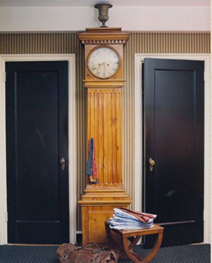 Mmmm...dark doors.  I have a hallway with 9 (9!) doorways and 8 ft ceilings.  Would that much dark door make the hall seem closed-in or claustrophobic?  Something to think about.