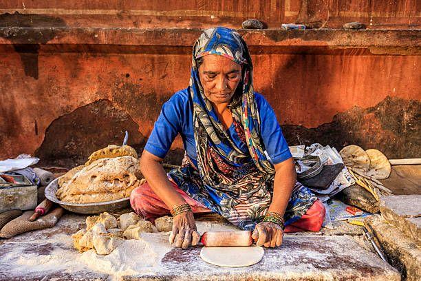 Indian street vendor preparing chapatti