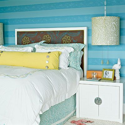 So cheery. Love the Striped Wall, Cozy Bed and that Lamp! #Bedroom
