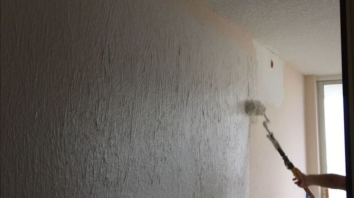 How To Skim Coat Walls Using The Paint Roller Trick Textured Walls Paint Roller Painting Over Wallpaper