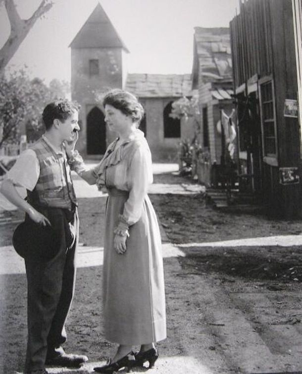 Helen Keller in Hollywood, being asked by Charlie Chaplin if she likes him, 1918