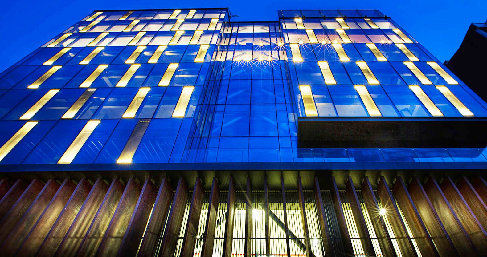 Avci architects transformed a derelict building into a striking led avci architects transformed a derelict building into a striking led lit company headquarters mozeypictures Image collections