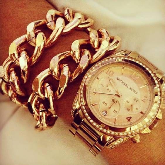 Gold watch, gold bracelets, gold everything