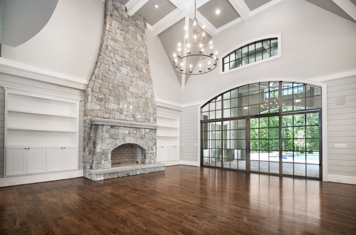 Living room GOALS! Floor to ceiling stone fireplace ...