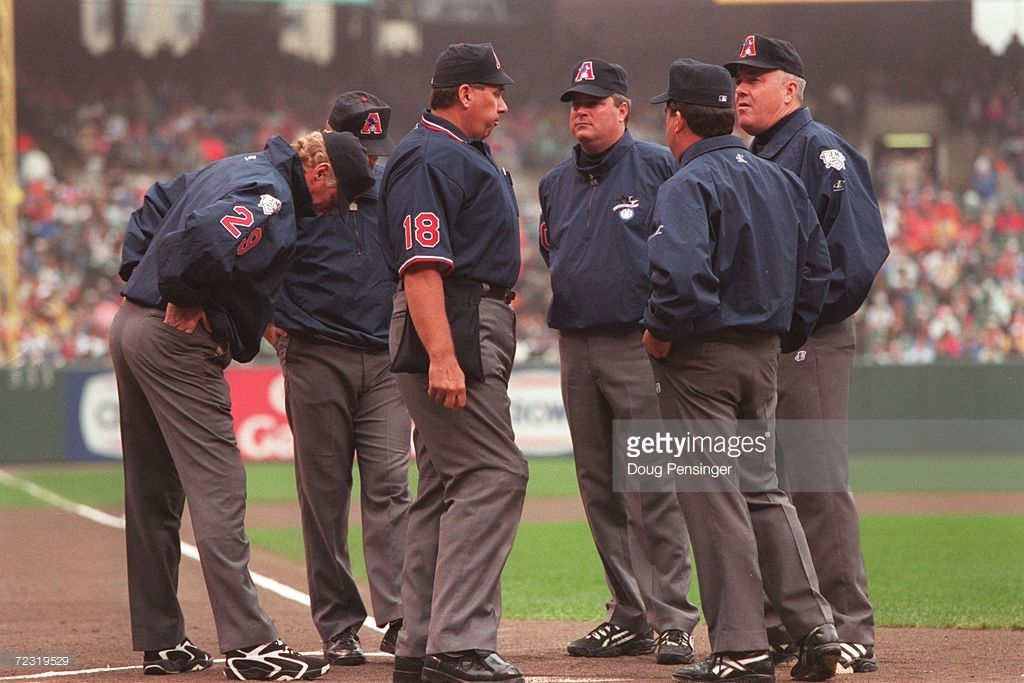 The Officiating Crew Of Umpires Greg Kosc Tim Tschida Tim Welke John Shulock Ted Hendry And Drew Coble Talk With One Crew American League Cleveland Indians