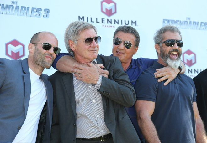 "Jason Statham, Harrison Ford, Sylvester Stallone, and Mel Gibson showed off their bromance on the red carpet of ""Expendables 3."""