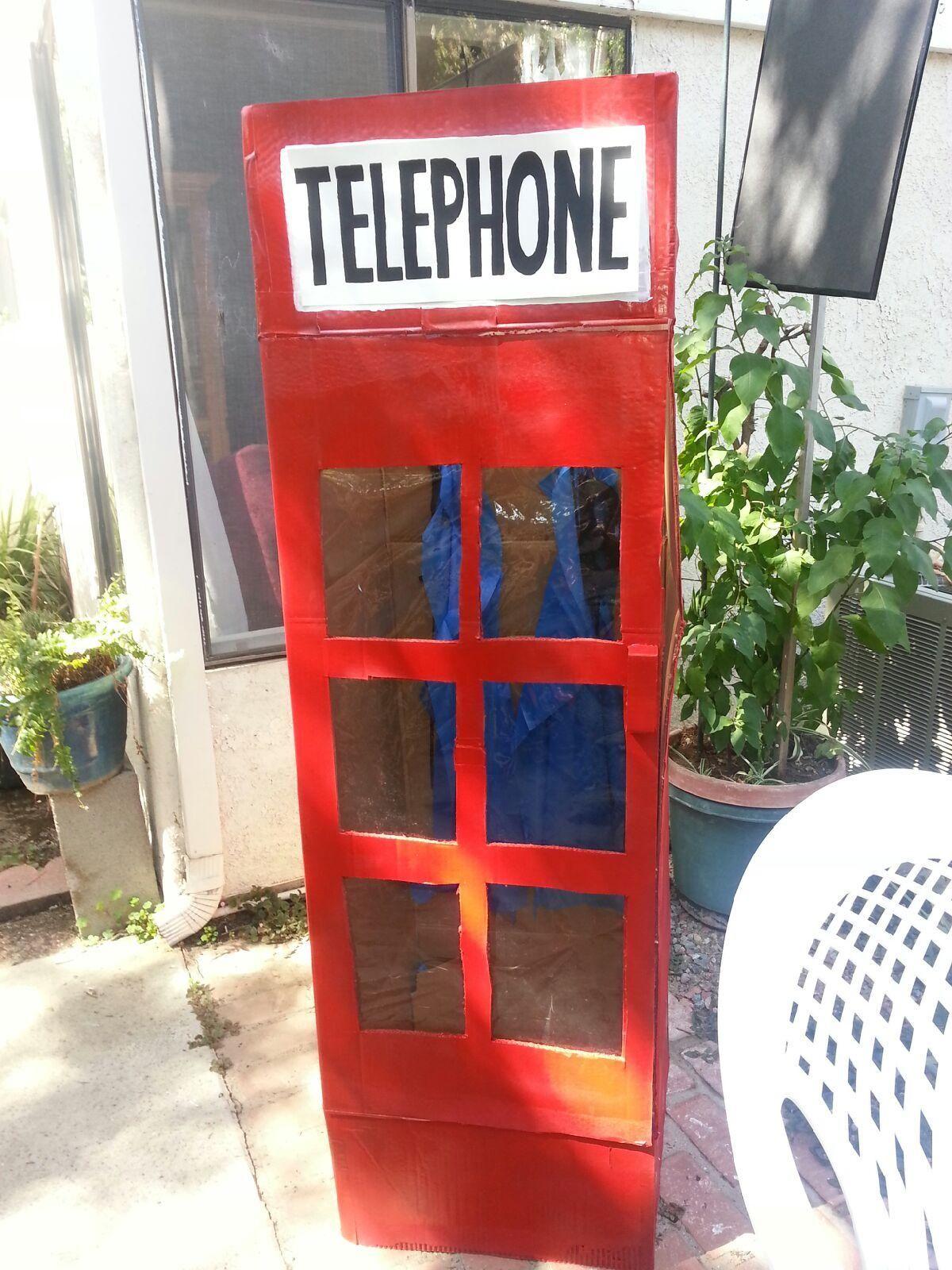 DIY Superhero phone booth made from a wardrobe box