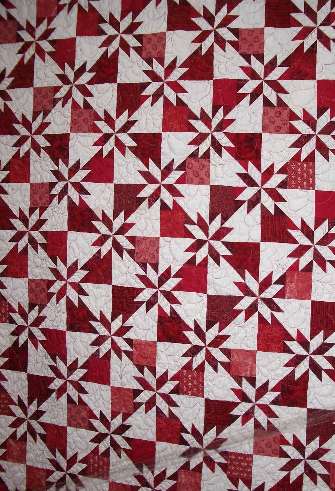 love red and white! this is my favorite (one of them anyway) quilt pattern. it works up great in all combinations including scrappy