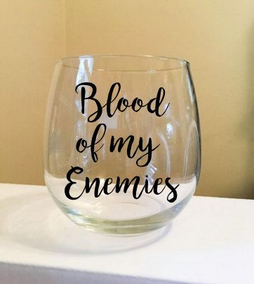 Wine glass with your choice of color - black or dark red vinyl lettering. Use code BUY2SAVE4 and save $4 on 2 glasses thru 12/17.