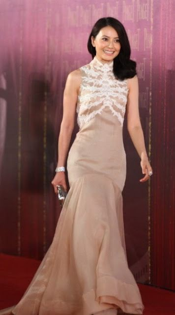 Gao Yuan Yuan's Alexander McQueen dress with the lace applique that goes up to the high neck collar