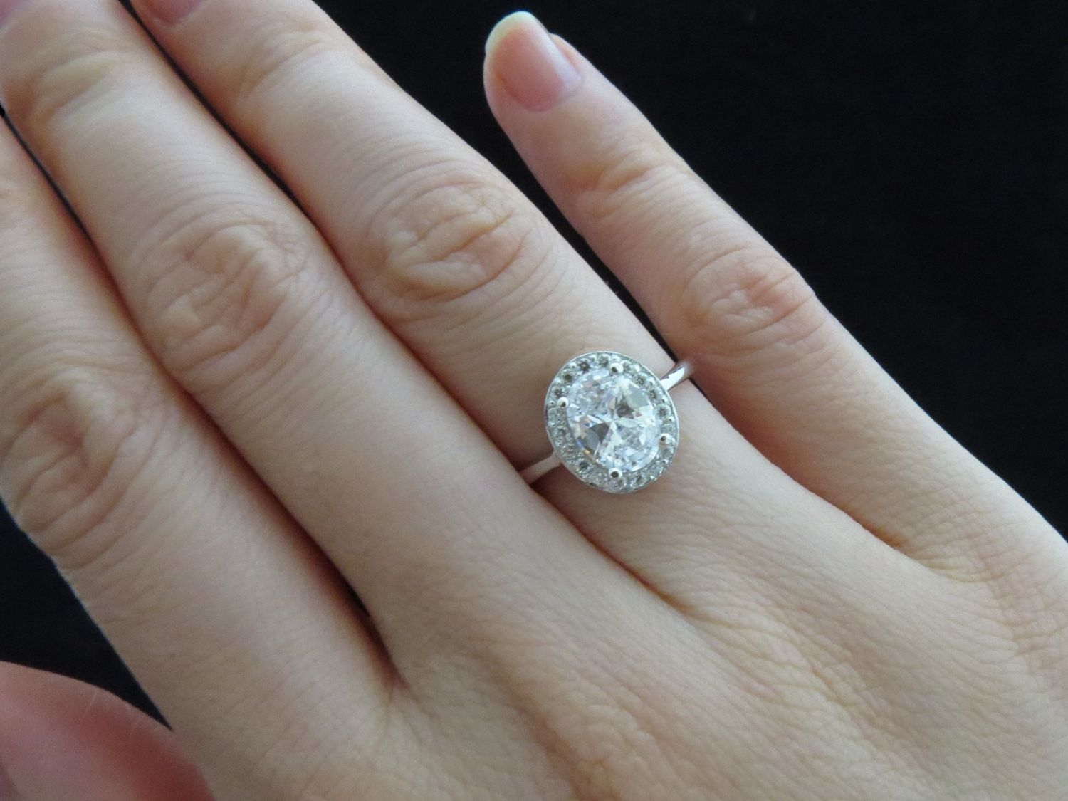 2 Carat Oval Diamond Ring On Hand