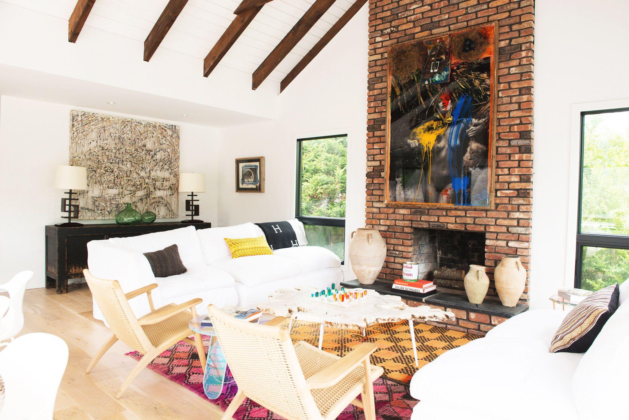 Tour a light and airy montauk home spacious living room brick