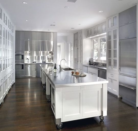 maybe we'll do all the countertops in stainless. love the white + reflective/stainless with the dark floor contrast.