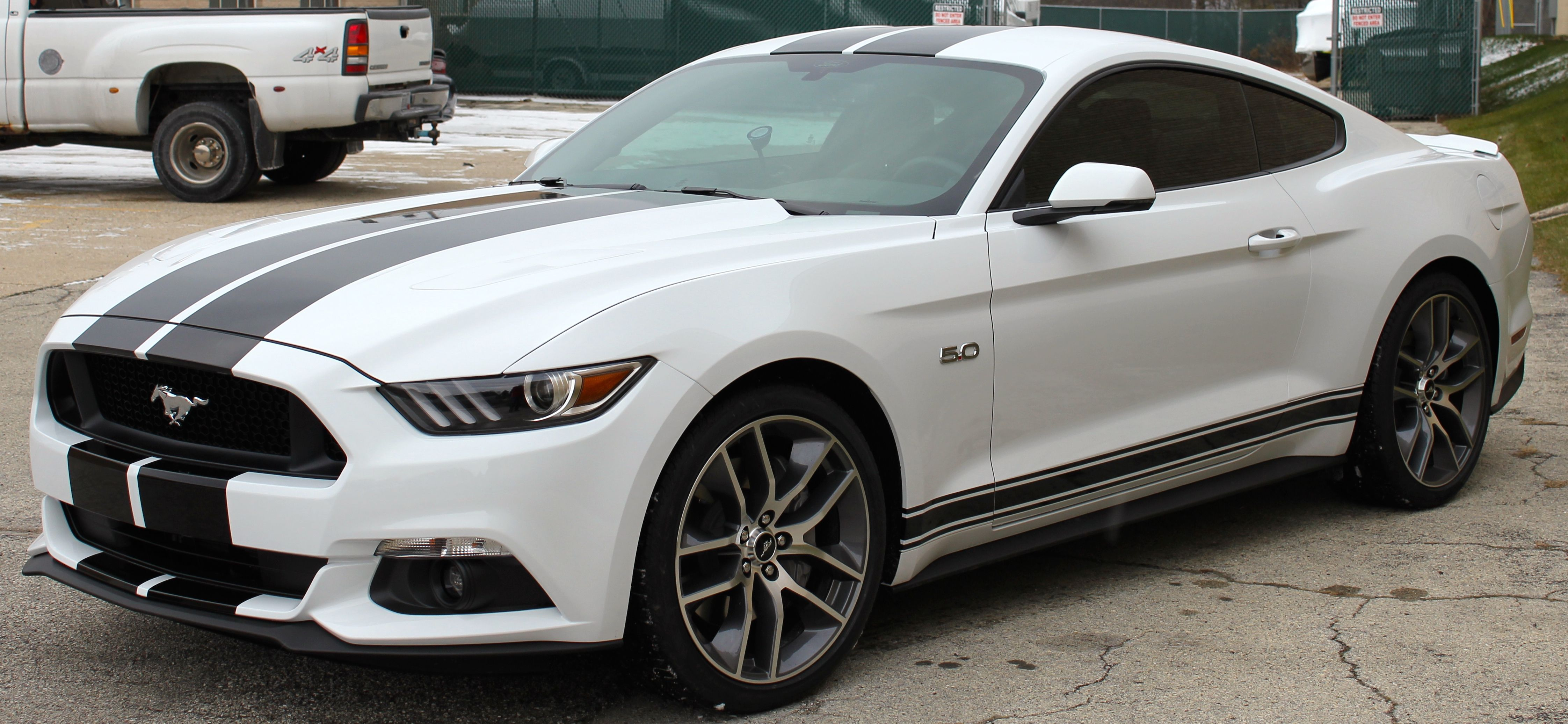 White mustang gt w black stripes side view