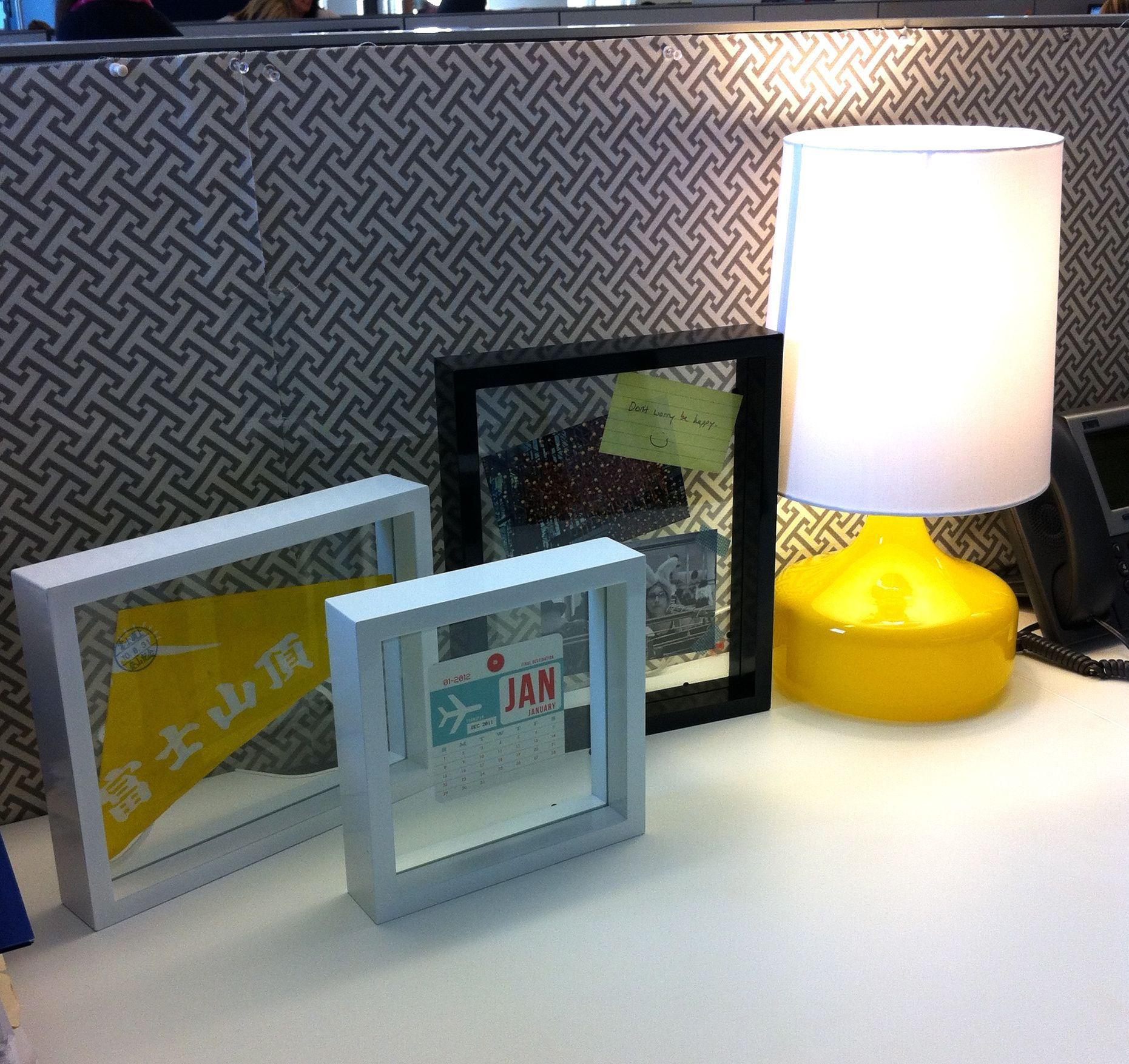 CubicleDecor Ideas - sunny lamps with bold color, floating frames, and fabrics to add pop to your space