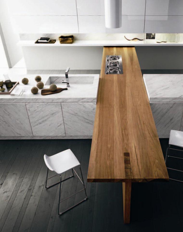 Le marbre est une pierre qu'on aime pour son aspect authentique et luxueux. Voici une galerie d'images inspirantes de cuisines avec plan de travail marbre !