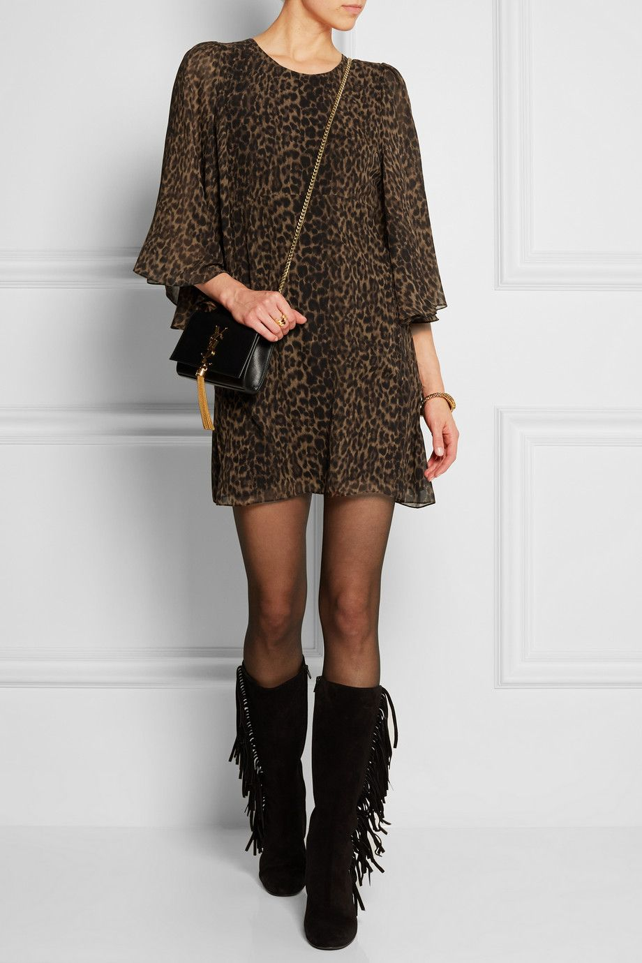the flow of this leopard dress...I'd like it with more classic accessories i think...play down the boho.