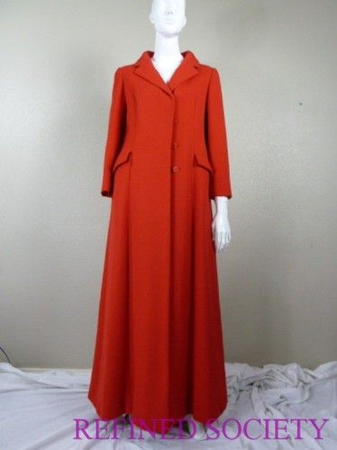 BILL BLASS for MAURICE RENTER '60s Vintage Red Wool Duster / Riding Coat I'm not sure about the riding coat part... they're usually short. I don't even want to think about trying to jump wearing this coat LOL. But a nice coat nontheless!
