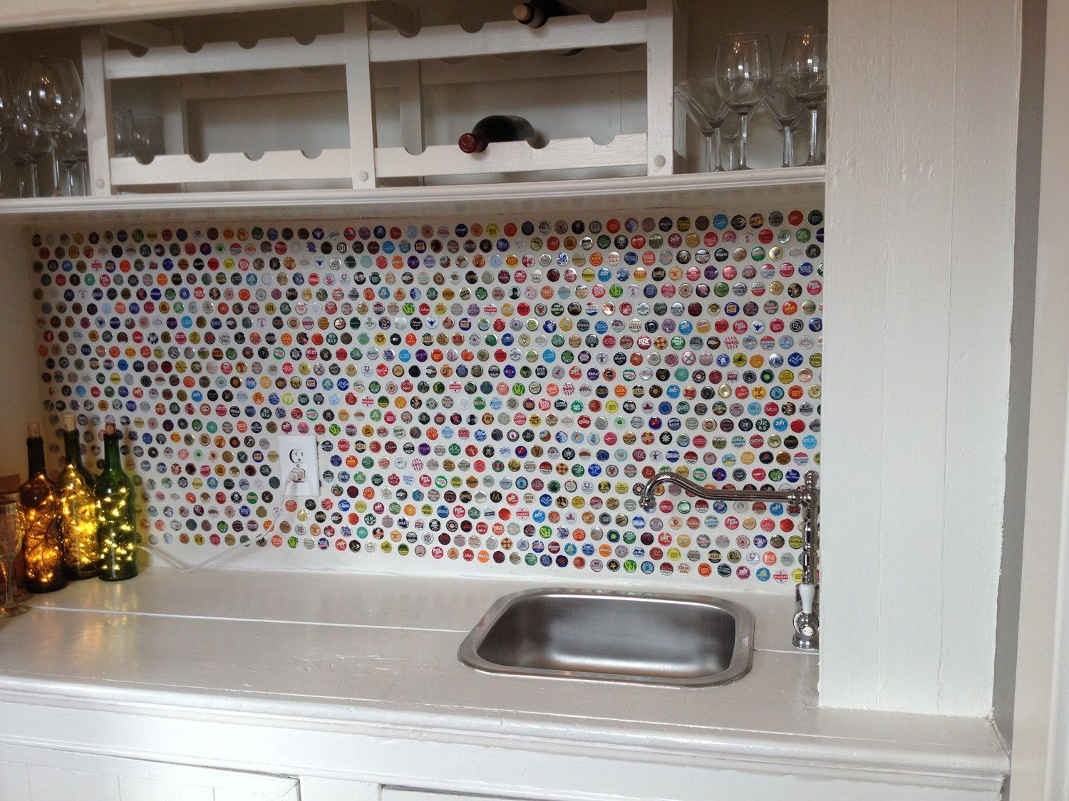 Photo for We saved money by using old bottle caps for our backsplash ...