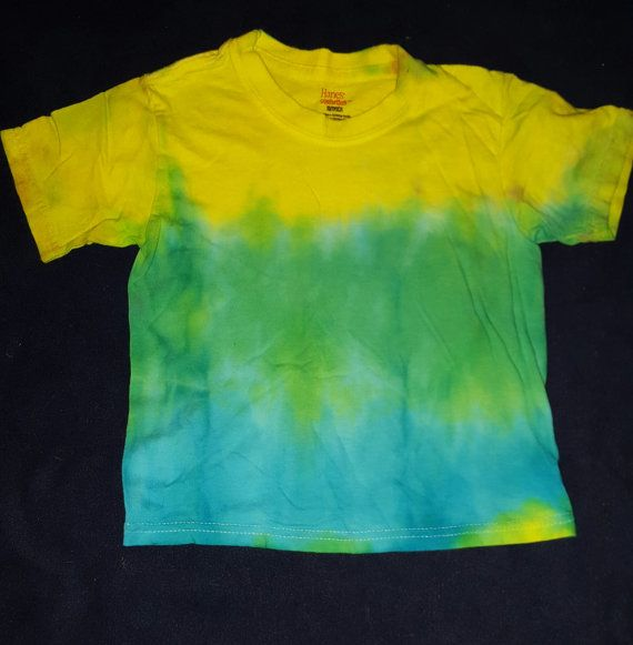 Check out this item in my Etsy shop https://www.etsy.com/listing/267040327/childs-blue-and-green-tie-dye-shirt-xs