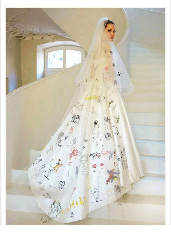 Versace wedding dress  Versace wedding dress Brangelinaus kidsu drawings embroidered on