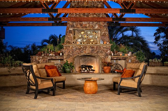 Awesome Outdoor Covered Patio With Stone Fireplace And Chair Cushion Sets