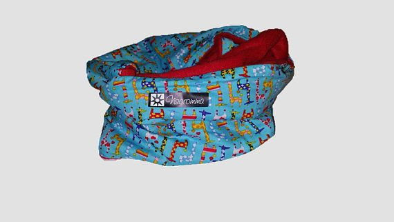 Children scarf of colorful fabric full of Adinkra symbolism from Ghana by the label guardianship special to give as a birthday present