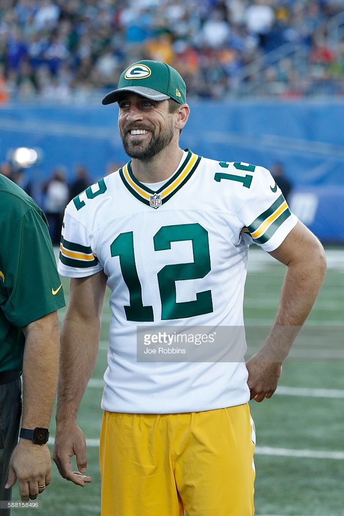 timeless design 51332 afdb6 Aaron Rodgers of the Green Bay Packers looks on after the ...
