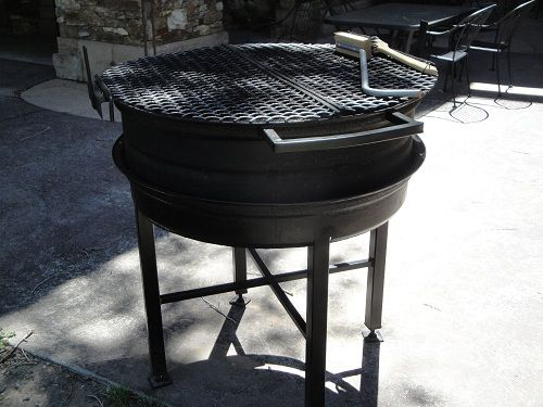 BBQ made from a tractor rim. The entire cooker breaks down ...