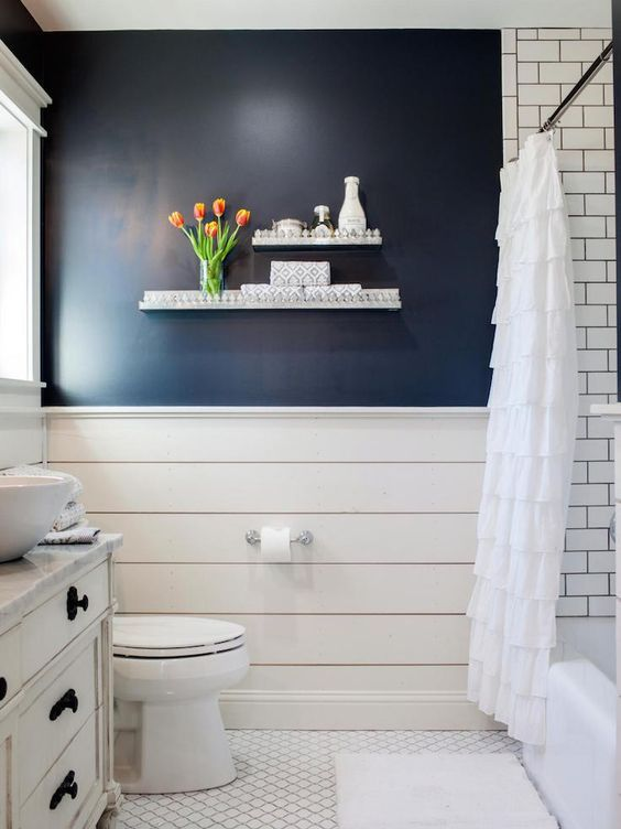 Navy Accent Wall Over White Shiplap In Country Bathroom