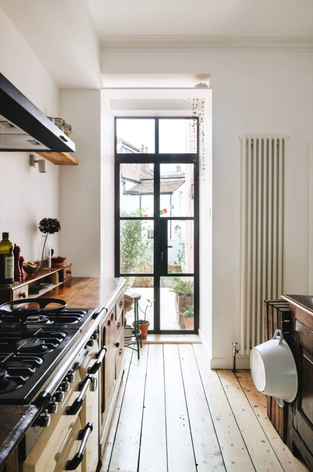Vintage Modern Kitchen With Natural Wood Floors And Steel Framed Glass Doors And Windows Steel Stee In 2020 Vintage Modern Kitchen Home Decor Styles Home Remodeling
