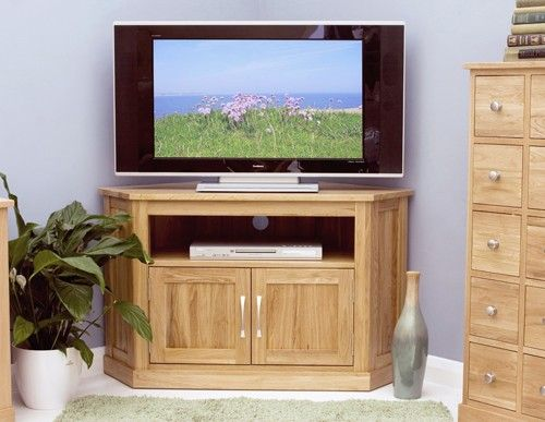brand new contemporary oak corner tv cabinet the overall dimensions of the corner tv unit are x x cm designed to hold a large up to lcd plasma or led
