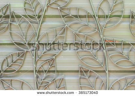 Design details of wrought iron fence on gate - stock photo