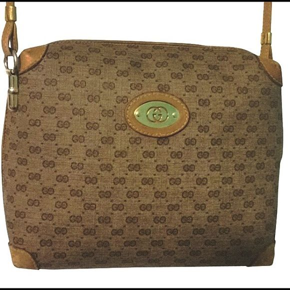 Authentic Gucci monogram canvas crossbody Gently used. Only visible in the minor leather wear. Gucci Bags Crossbody Bags