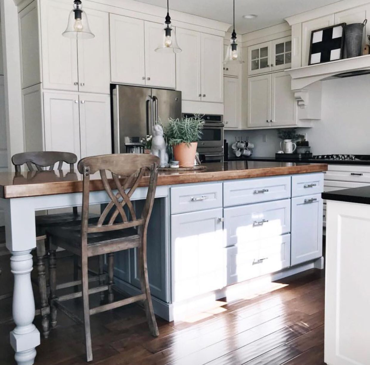White farmhouse kitchen with glass door uppers White