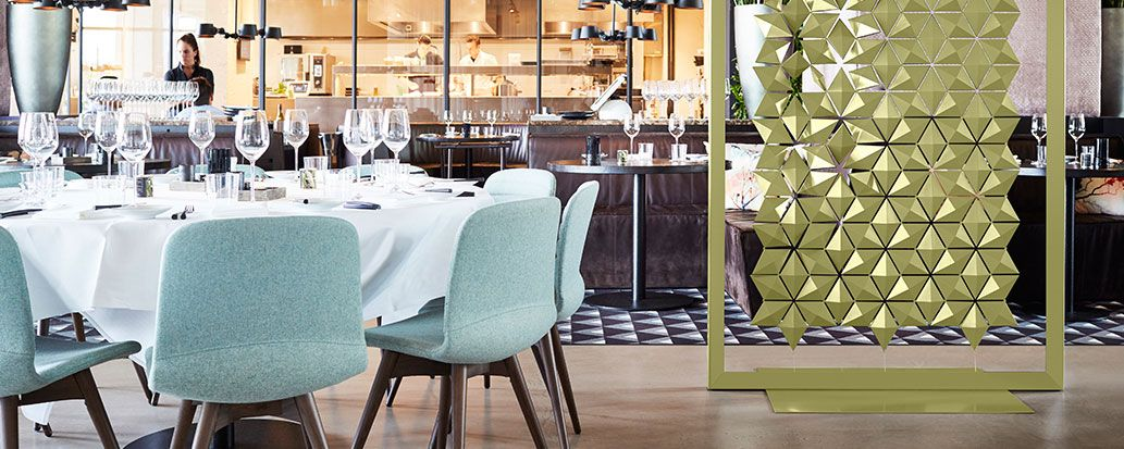 Large Transparant Room Divider Screen To Divide Seating Areas And Tables In  A Restaurant.