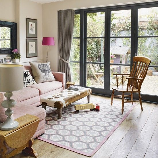 living room with picture window and pale pink sofa housetohome co