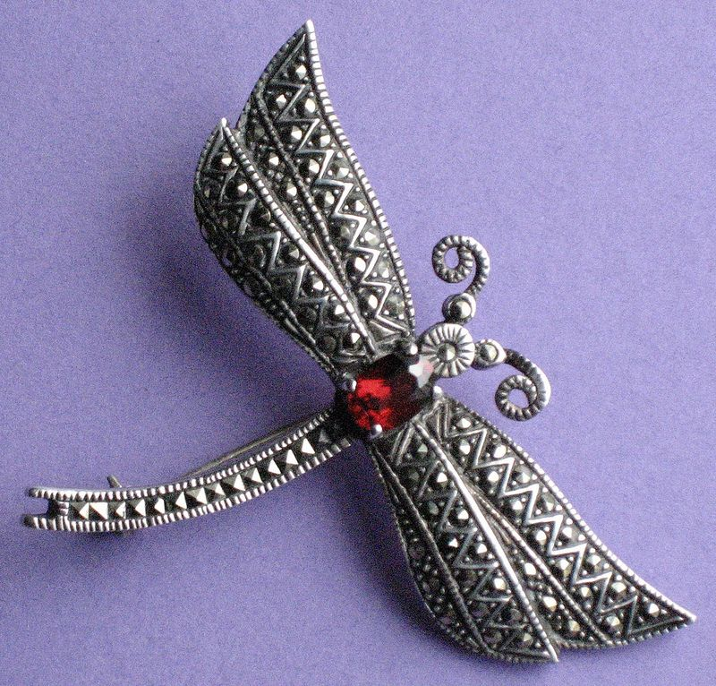 A small marcasite moth brooch with red stone. Sold by www.gillianhorsup.com