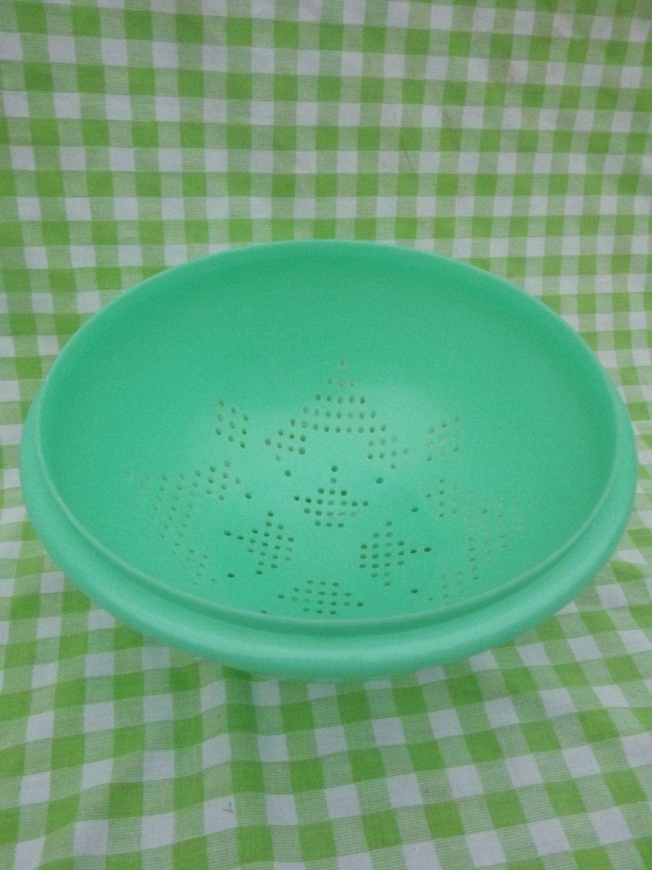 Vintage Tupperware Colander Jadeite Green. $9.00, via Etsy.  Sold these back in 60's.  I still use it.   MJ