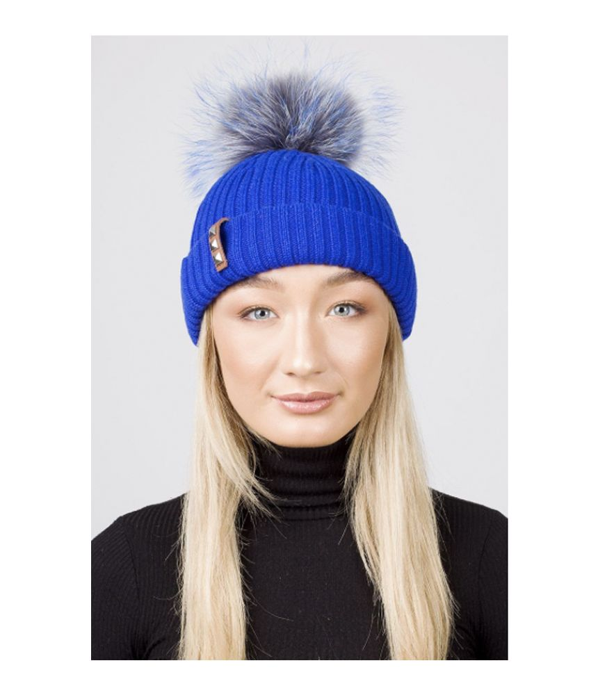 BKLYN  BKLYN Electric Blue and Grey Pom Pom Bobble Hat: Luxury Italian merino wool bobble hat from BKLYN in Electric Blue with Grey/Blue pom pom. Ideal for the winter season and will add an element of style and fun to any outfit.  - Signature leather label with studs - Fine fibres which blend and feel gentle next to your skin and kind on your hair - Raccoon Fur Pom Pom uniquely coloured to each hat - Detachable via a metal popper