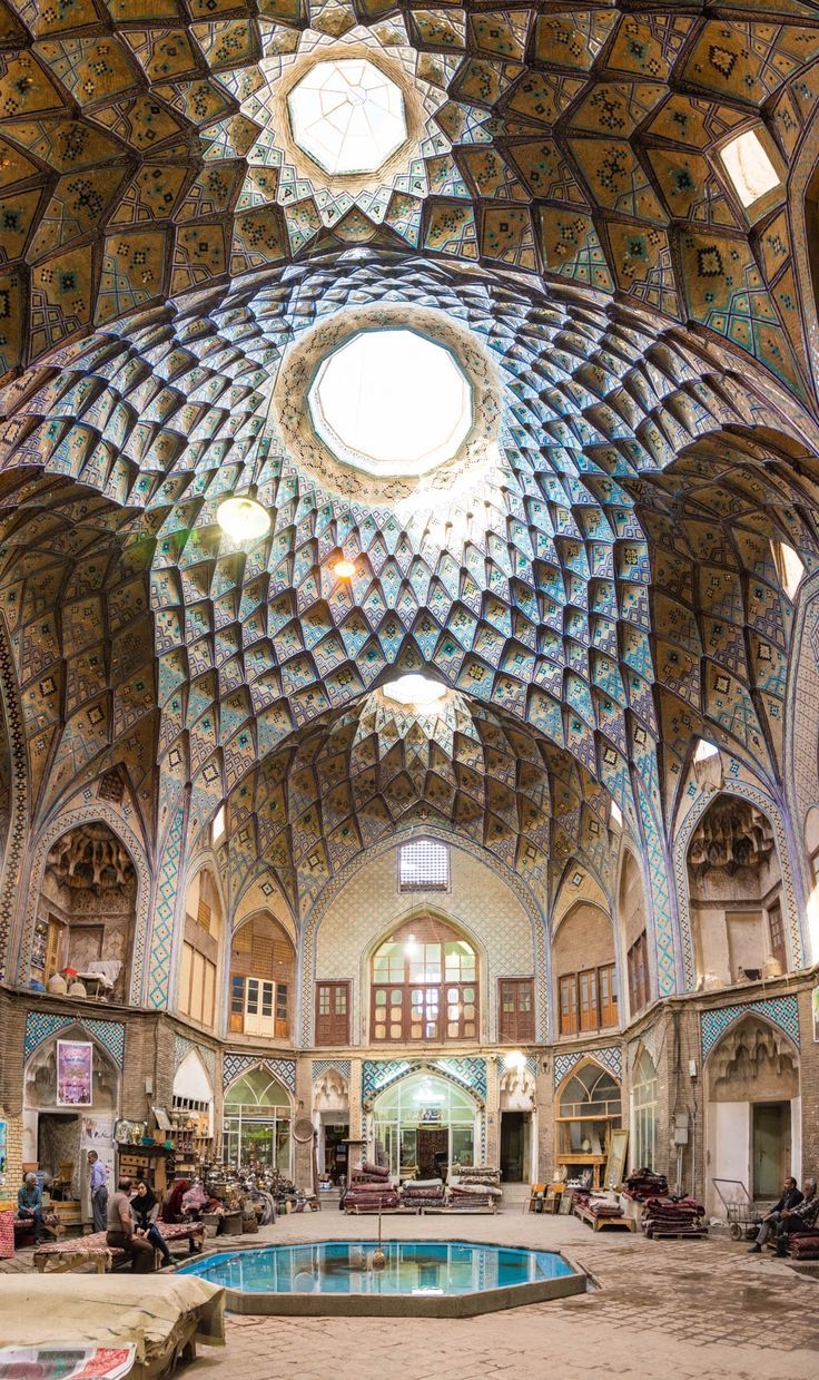 A caravanserai in the center of the bazaar in Kashan, Iran.  The architecture and colors in Iran are absolutely absurd! Iran Travel Destinations | Iran Honeymoon | Backpack Iran | Backpacking Iran | Iran Vacation | Iran Photography | Middle East #travel #honeymoon #vacation #backpacking #budgettravel #offthebeatenpath #bucketlist #wanderlust #middleeast #Iran #exploreIran #visitIran #TravelIran #IranTravel