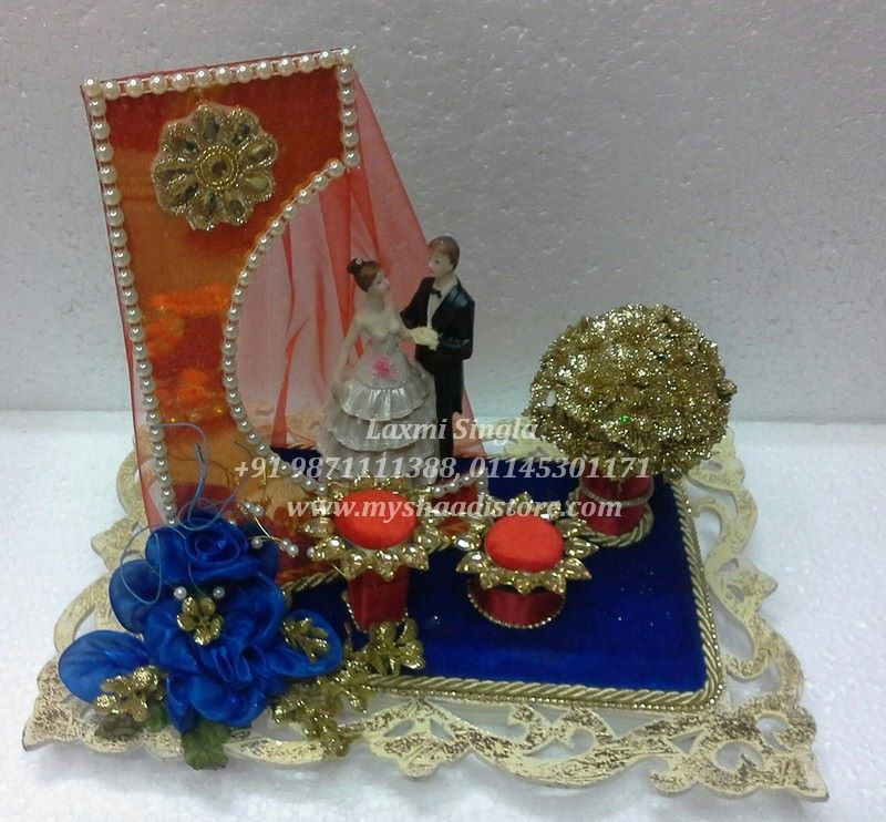 Pin by the wedding designers by laxmi singla on engagement ring platter tray wedding decorations engagement rings wedding rings commitment rings trays wedding decor diamond engagement rings junglespirit Images