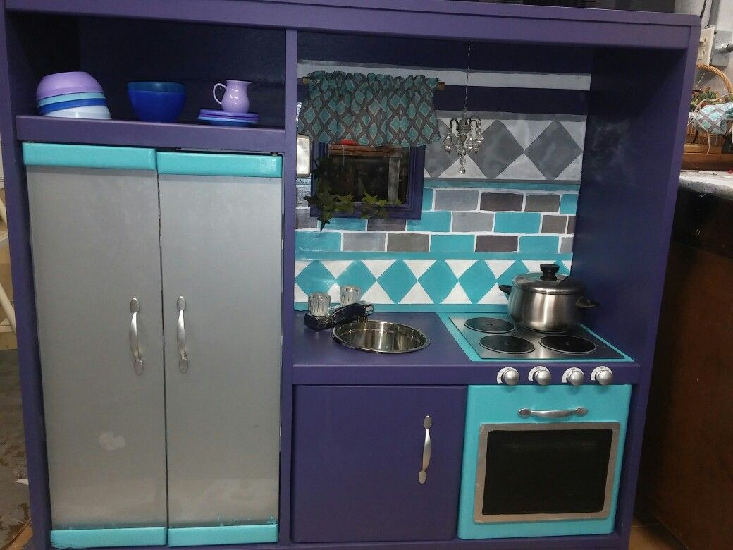 diy..from entertainment center...purple and aqua color silver ...