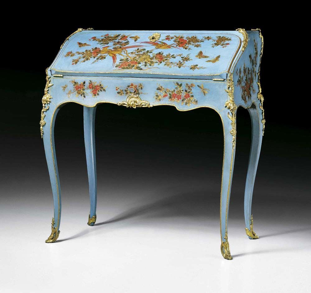 """LACQUER LADY'S DESK """"EN VERNIS MARTIN"""", Louis XV, BVRB (Bernard II Van Risenburgh, maitre 1735) attributed, Paris circa 1750/55. Wood painted on all sides in """"vernis Martin"""" in the """"Chinese style""""; with polychrome decoration of exotic birds, butterflies and flowers on sky blue ground. The interior with fine marquetry in tulipwood in """"bois de bout"""". The fall front leather lined writing surface enclosing fitted interior. Exceptionally fine matte and polished gilt bronze mounts and sabots…"""